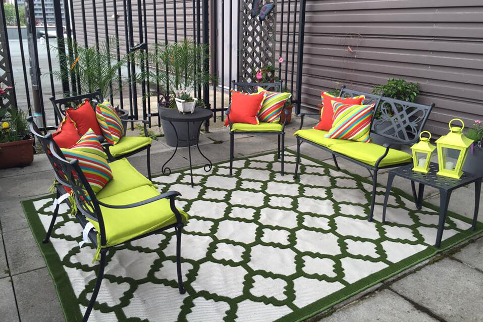 patio area with furniture and carpet