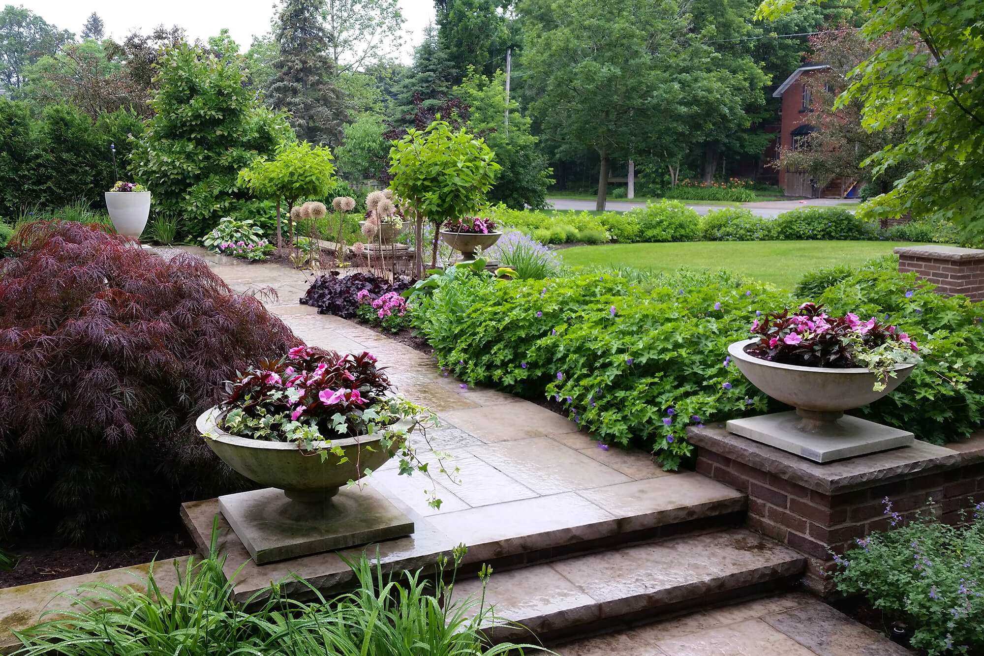 garden path with urns and plants